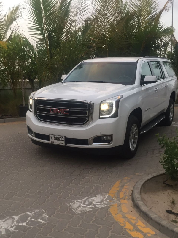 hire GMC Yukon XL (Bright White), 2017 in Dubai